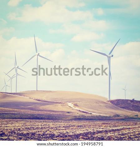 Modern Wind Turbines Producing Energy in Spain, Retro Effect - stock photo