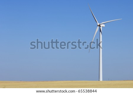 modern windmill for renewable electric energy production in an area of farmland - stock photo