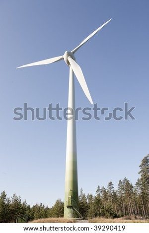 Modern windmill producing renewable energy ecologically.