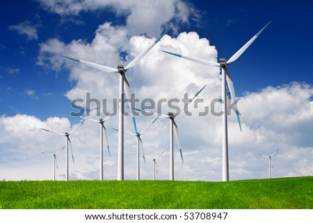 Modern windmills on a green hill with blue sky