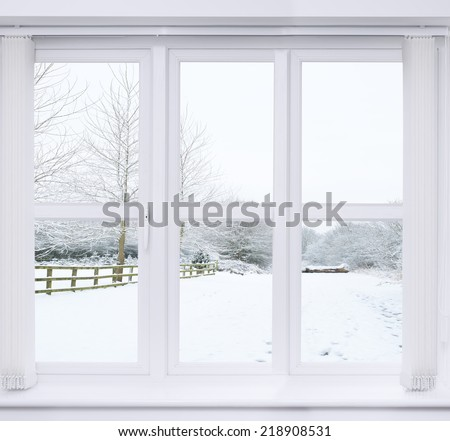 Modern window with snow scene outside - stock photo