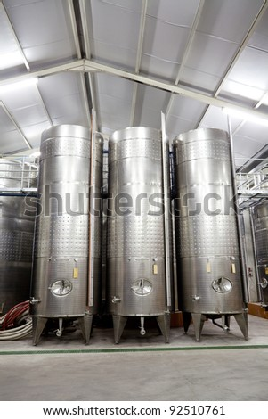 modern winery with large stainless steel barrels - stock photo