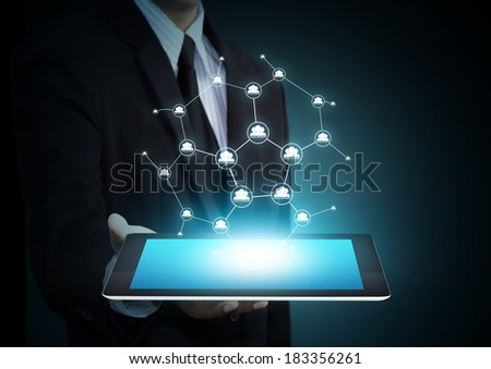 Modern wireless technology and social media on tablet - stock photo