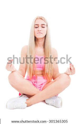 Modern woman siting in yoga lotus position meditating isolated on white - stock photo