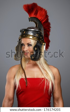 Modern woman wearing an acient centurion headgear - stock photo
