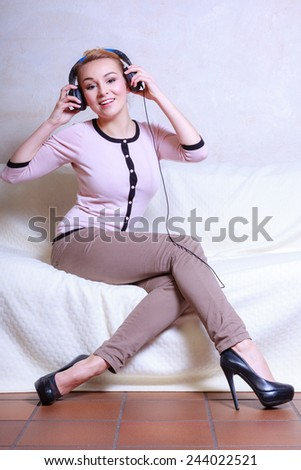 Modern woman with headphones listening to music - stock photo