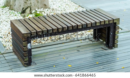 Modern Wood And Steel Bench In The Park