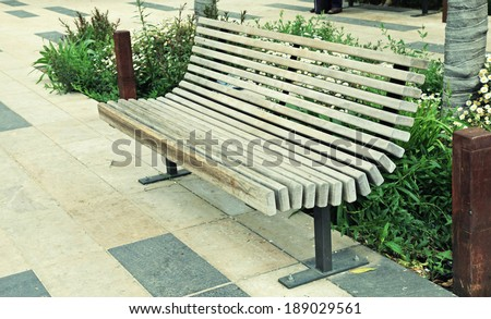 modern wood bench on the city street - stock photo