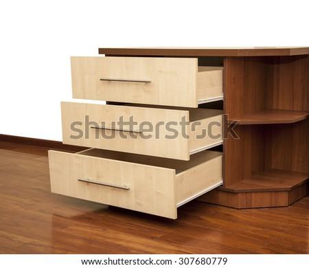 modern wooden nightstand on the floor in bedroom - stock photo