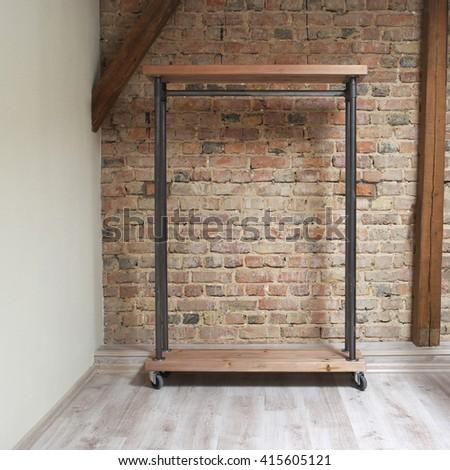 modern wooden rack in the loft interior  - stock photo