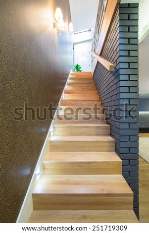 Modern wooden staircase in new exclusive house - stock photo