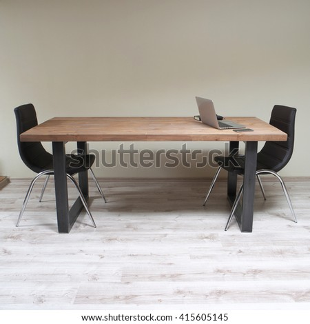 modern wooden table in the loft interior  - stock photo