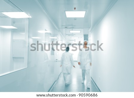 Modern working environment, people walking inside - stock photo