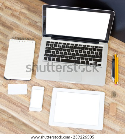 Modern working place with empty computer, tablet, phone  and  notebook - stock photo