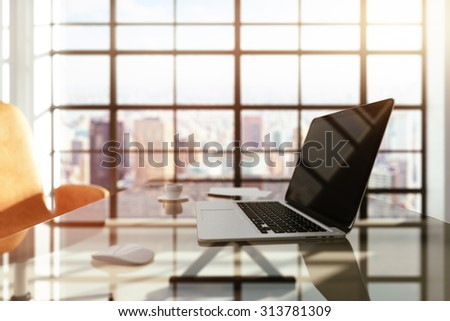 modern workplace with a laptop at sunrise - stock photo