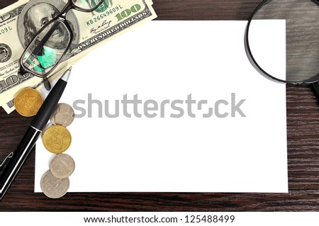 Modern workplace with blank paper on table - stock photo