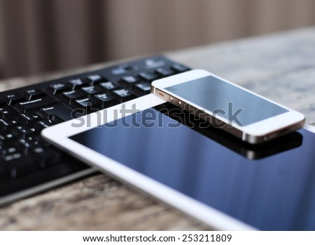 Modern workplace with digital tablet computer and mobile phone - stock photo