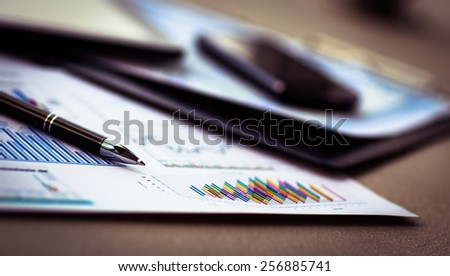 Modern workplace with digital tablet computer and mobile phone, pen and papers - stock photo