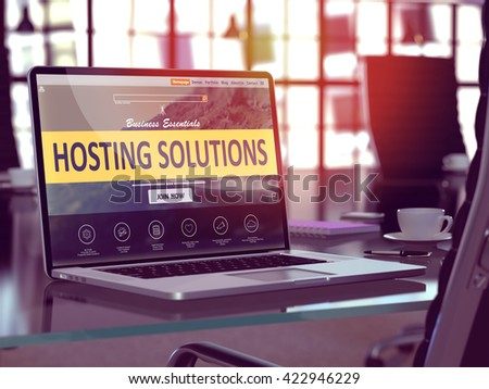 Modern Workplace with Laptop showing Landing Page with Hosting Solutions Concept. Toned Image with Selective Focus. 3D Render. - stock photo