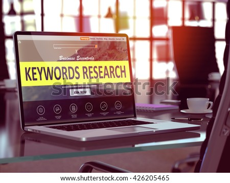 Modern Workplace with Laptop showing Landing Page with Keywords Research Concept. Toned Image with Selective Focus. 3d Rendering. - stock photo