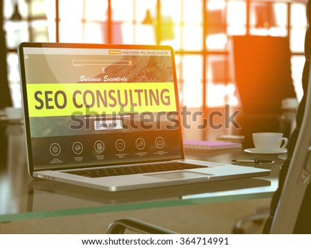 Modern Workplace with Laptop showing Landing Page with SEO - Search Engine Optimization - Consulting Concept. Toned 3d Image with Selective Focus. - stock photo