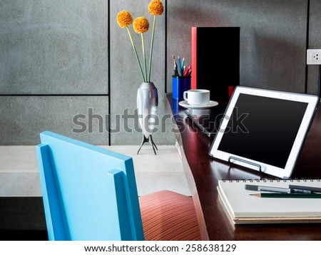 Modern workplace with tablet computer ,flower vase and laptop on desktop - stock photo