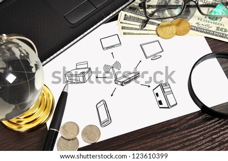 Modern workplace with wi-fi scheme on paper - stock photo
