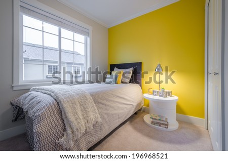 Modern yellow bedroom interior in a luxury house - stock photo