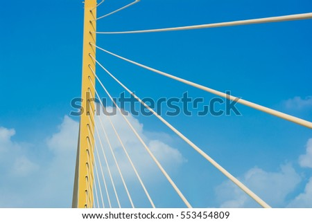 Modern Yellow cable Bridge against blue sky in Bangkok, Thailand.