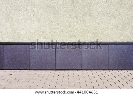 Modern yellow plaster street wall background - stock photo