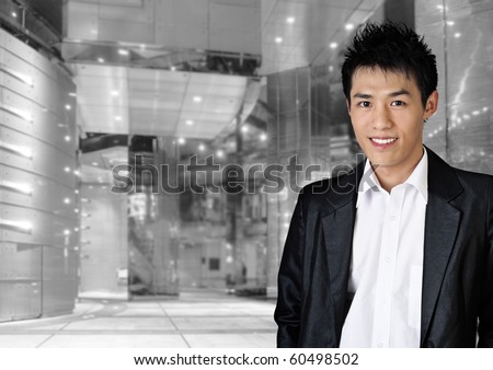 Modern young business man of Asian in office. - stock photo