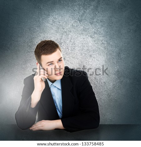 Modern young businessman talking on smart phone