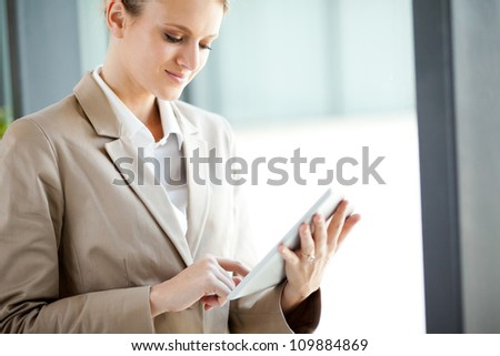 modern young businesswoman with tablet computer - stock photo