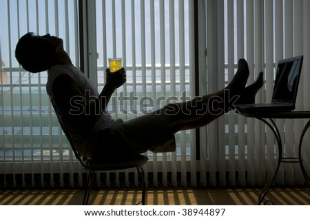 Modern young casual man indoor, modern building at background - stock photo