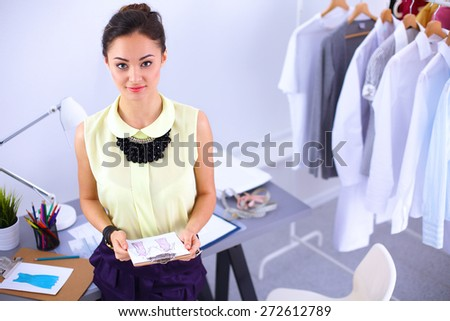 Modern young fashion designer working at studio