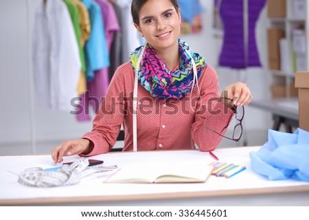 Modern young fashion designer working at studio. - stock photo