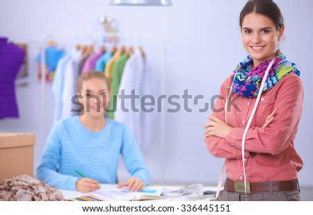 Modern young fashion designers working at studio. - stock photo