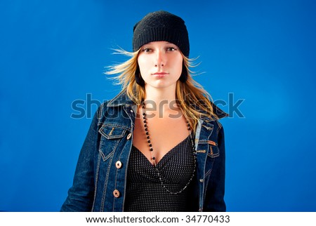 Modern young girl in jeans jacket - stock photo