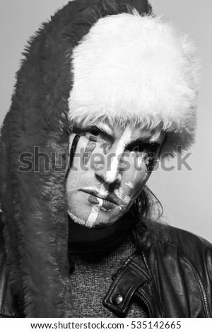 modern young Santa Claus portrait in black leather jacket painted by face, humor bw