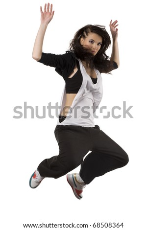 modern young woman dancer in hip hop style jumping over white background