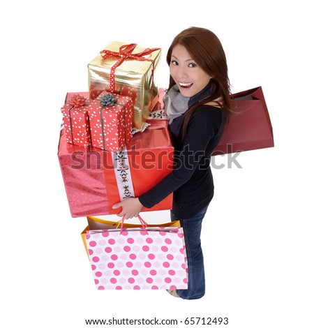 Modern young woman holding bags and gifts with smiling and happy expression isolated over white. - stock photo