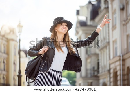 Modern young woman in a big city - stock photo