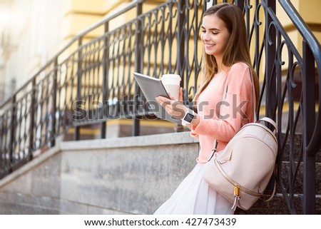 Modern young woman in a big city