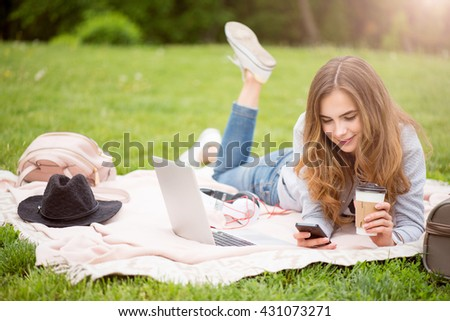 Modern young woman in a park - stock photo