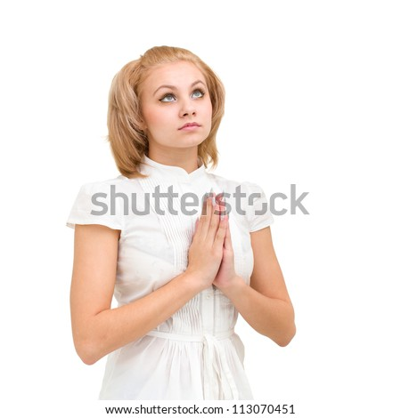modest young woman praying, isolated on white background - stock photo