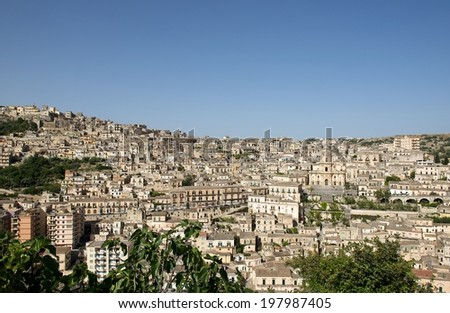 Modica city on sunny clear summer day, Sicily, Italy, Europe, sicilian landscape, Modica town, Modica panorama, panoramic view of Modica village - stock photo