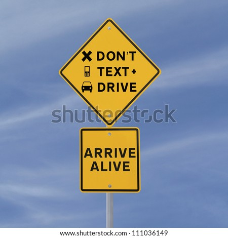 Modified road sign warning of the danger of texting and driving (against a blue sky background) - stock photo