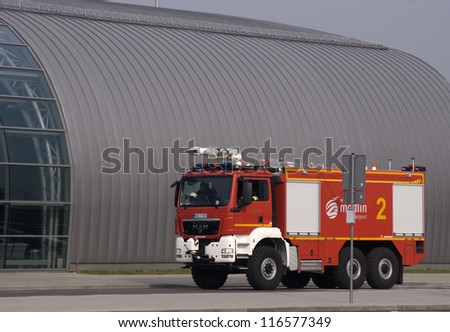 MODLIN AIRPORT, POLAND - OCTOBER 3: Anti-terrorist squad, police and fire brigade inspect the airport after a bomb alarm made by telephone by an unknown person at October 3, 2012, Modlin, Poland.