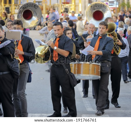 Modugno , Italy - 23 September 2013: Procession of the patron saint, which took place the main streets in Modugno (Bari). The procession is accompanied by a band playing popular marches and religious  - stock photo