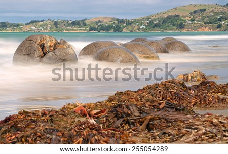Moeraki Boulders near Hampden, New Zealand - long time exposure - stock photo